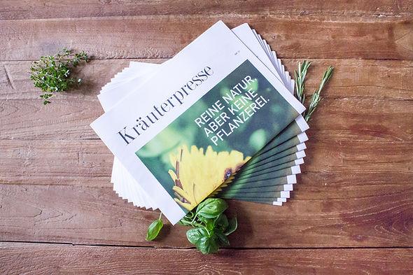 Drapal Kräuterpresse, Markengeschicht verpackt im Zeitungsformat