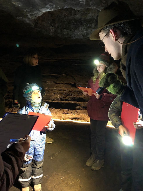 Children enjoying a research expedition around the caves at Caves of Hella in Iceland