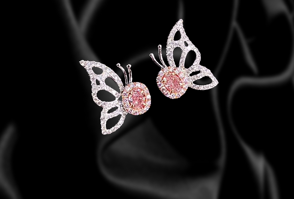 18kt white gold butterfly stud earrings with pink diamond centerpiece