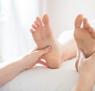 Feet having reflexology treatment