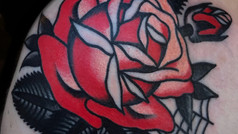 red rose traditional shoulder tattoo