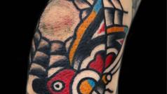 spiderweb and butterflu tattoo
