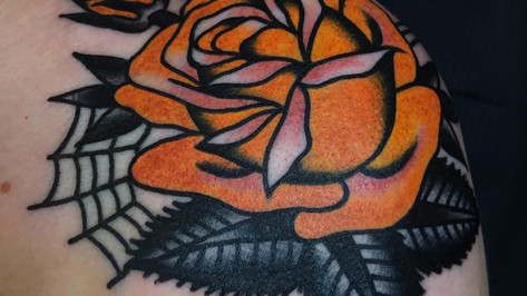 rose shoulder yellow tattoo