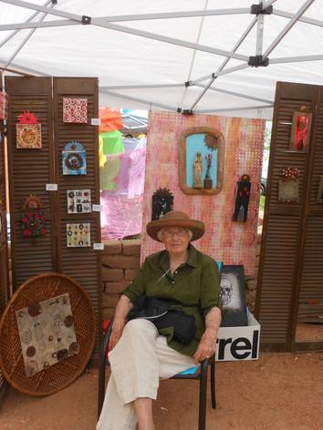 Marcia sits John's Booth.JPG