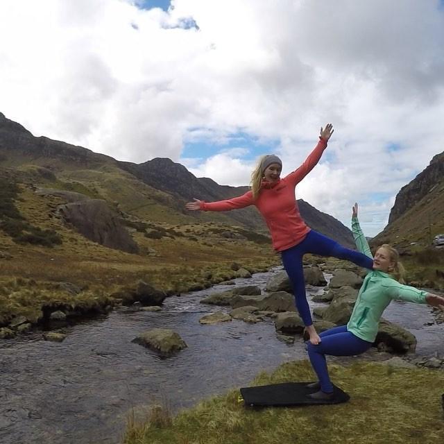 Leah and Shauna acroyoga on a trip to Wales