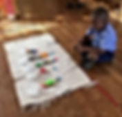 Boy with montessori materials.jpg