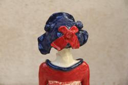 Dos Femme chapeau bleu