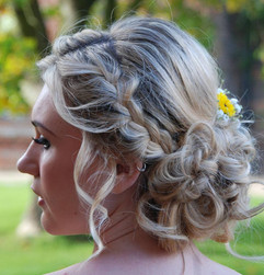 Soft braided up do at Layer Marney Tower