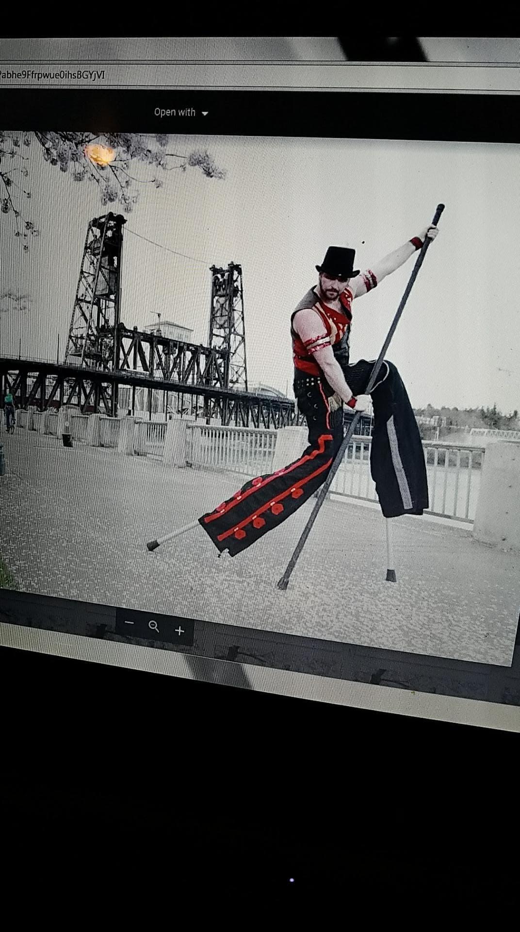 Performing Stilt Walker, professional co