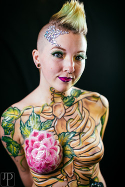 Body paint by artist Sarah Pearce in Portland Oregon, skeleton, vines, pocket watch, bow and arrow,