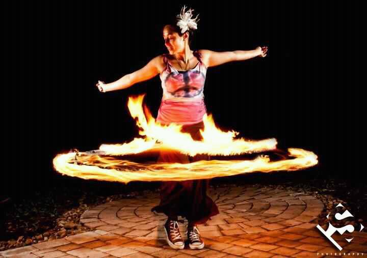 Fire dancer performer with Earth Fairy Entertainment in Portland Oregon, professional corporate ente