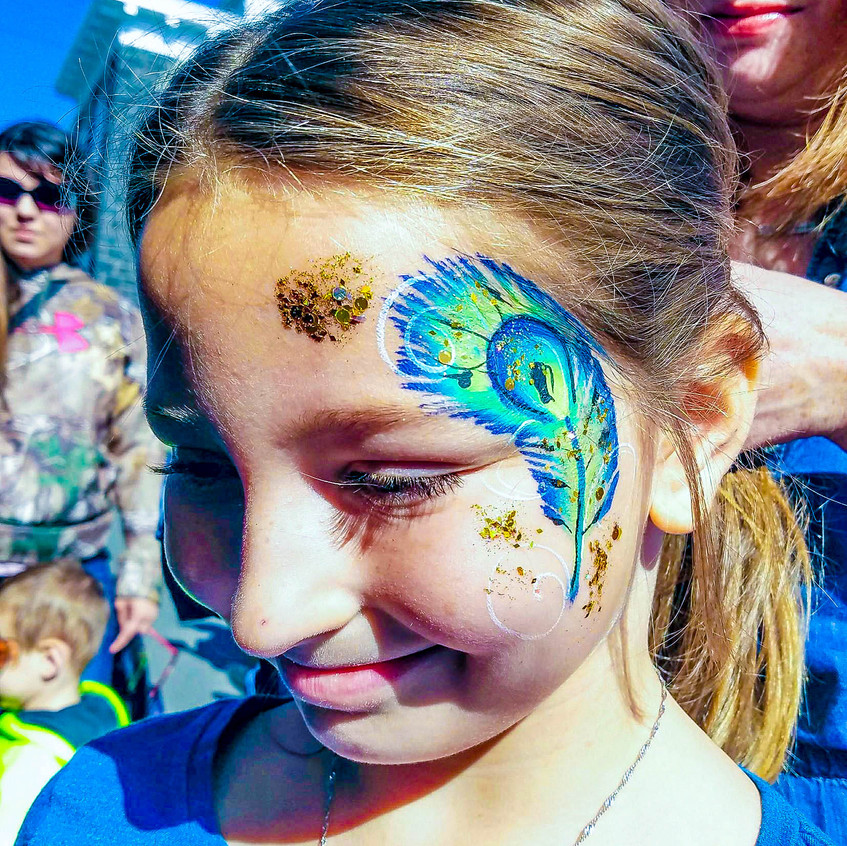 Earth Fairy Entertainment booth from Portland, at Spirit of Halloween Town in  St Helens Oregon, peacock feather face paint by Sarah Pearce