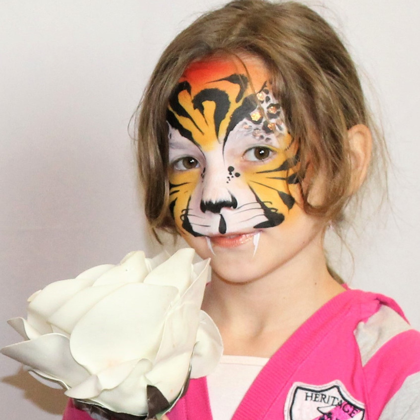 tiger face paint by artist Sarah Pearce