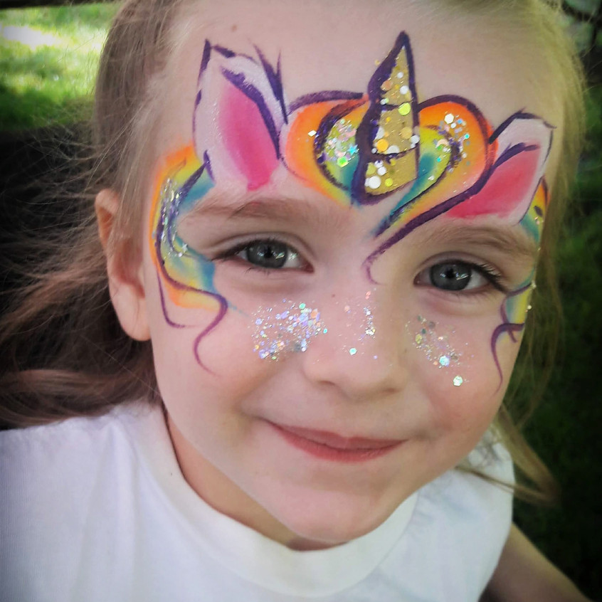 Unicorn face paint with Earth Fairy Ente