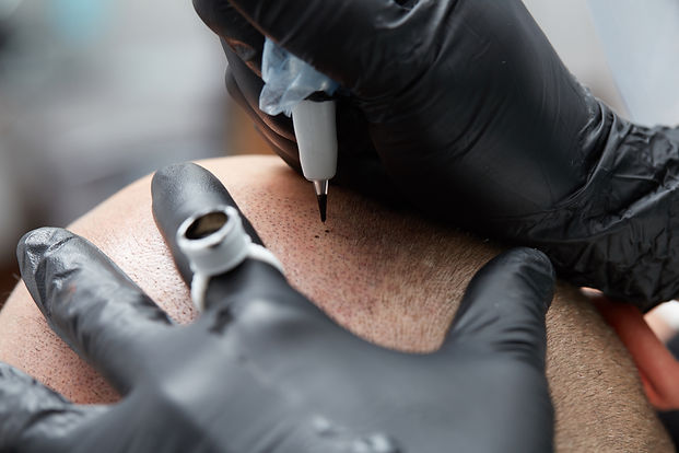 Cosmetologist making permanent makeup on