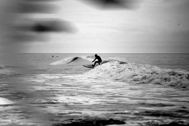 Surfer at Rest Bay