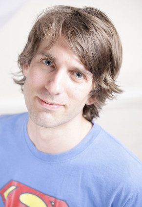 Headshot of Alex by Michael Wharley