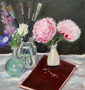 Flowers, brushes and Poussin book