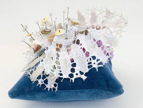 """Pincushion II: Lacey Relic, 2020 Velvet, thread, industrial felt, resin casted thimbles, lace, dressmaker pins, insect pins, interfacing fabric, acrylic paint, glass beads 5.5"""" x 7"""" x 6.25"""""""