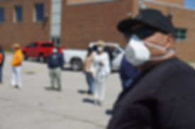 Man in mask silhouette of crowd.JPG