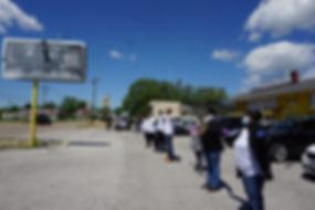 People standing in line on lot.JPG