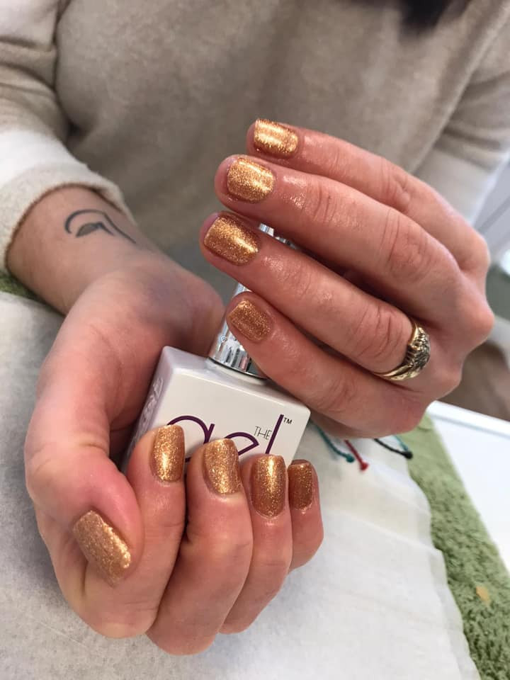 gel bottle manicure gold.jpg