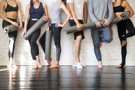 Group of young sporty people standing at