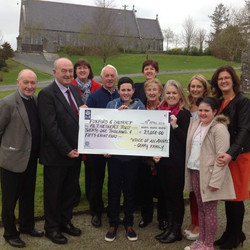 Cathal Gavin presenting charity cheque