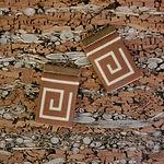 Brown Greek key earrings flat surface.jp