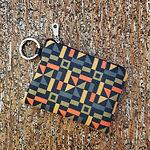 multi colored mini wallet angled.jpg