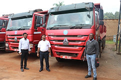 Minister Peter Ogwang (R) receiving 20 t