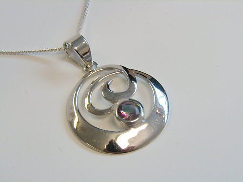 Sterling silver circular pendant with mystic topaz
