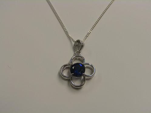 Sterling silver flower with sapphire centre