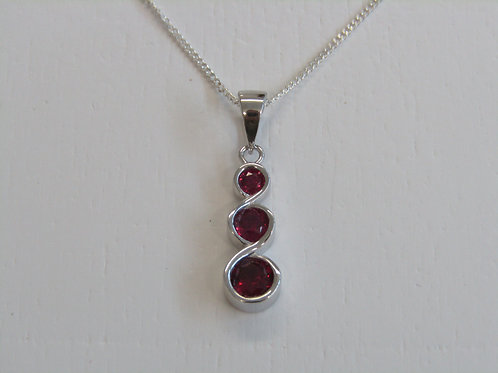 Sterling silver ruby circle pendant