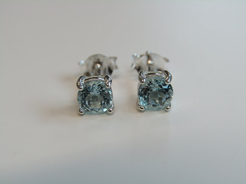 Sterling silver blue topaz claw set studs