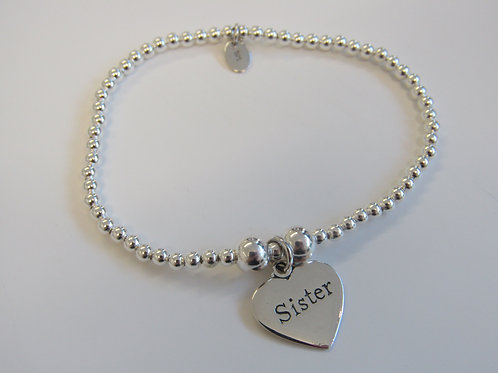 """Sterling silver stretchy bead bracelet with """"sister"""" charm"""