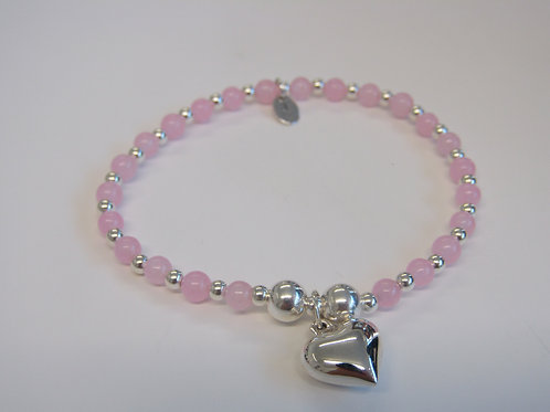"Sterling silver and pink  stretchy bead bracelet with ""heart"" charm"