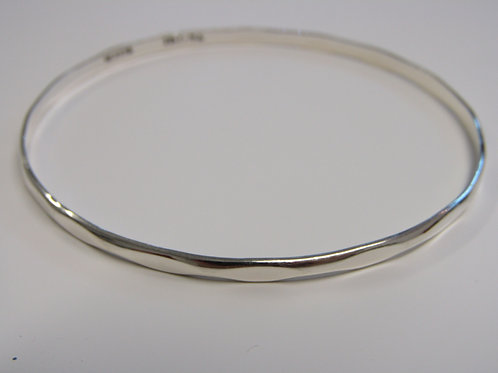 Sterling silver solid bangle with wave detail