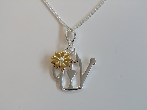 Sterling silver watering can with flower