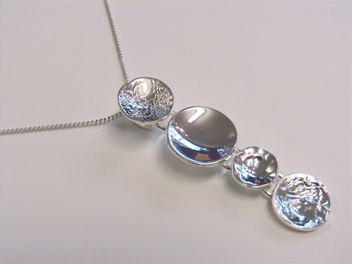 Sterling silver hammered and plain disc pendant