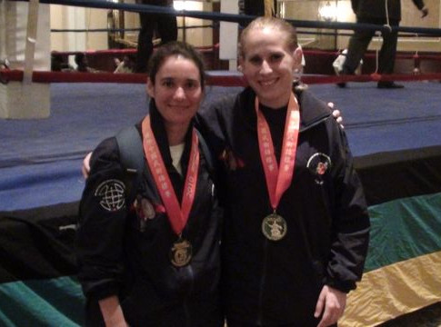 Female fighters with gold medals.jpg
