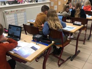 Werken met de laptops