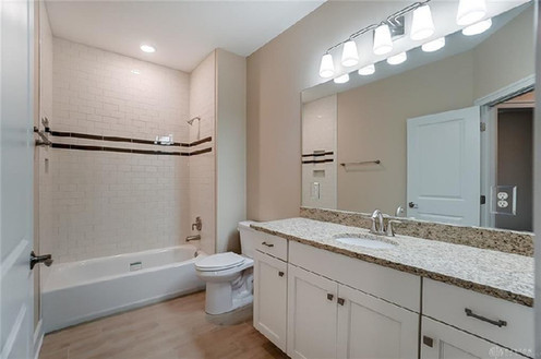 Dungan Custom Homes - Subway and Granite Guest Bath