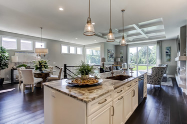 Dungan Custom Homes - White Kitchen Opens to Sleek Main Floor