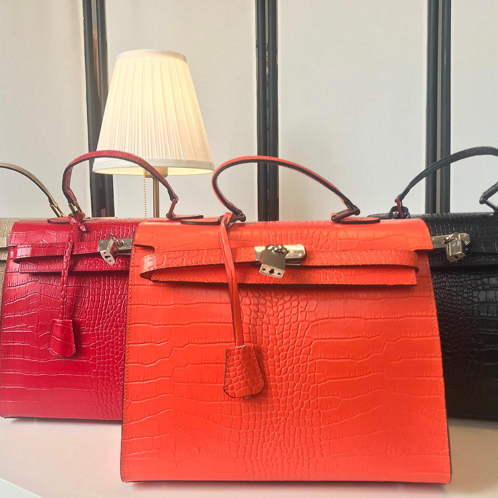 D Ou Vient Le Cuir sac à main kelly rouge effet reptile   eljawariya