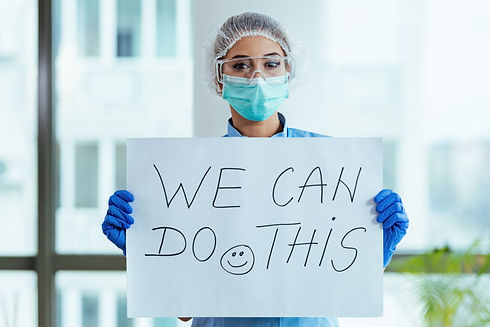 Healthcare worker holding placard with s