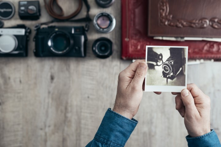 Man holding an old photograph
