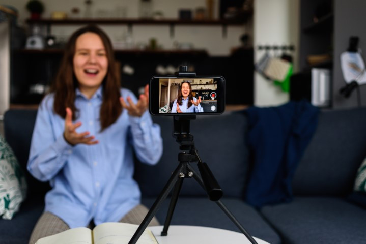 woman recording video with smartphone