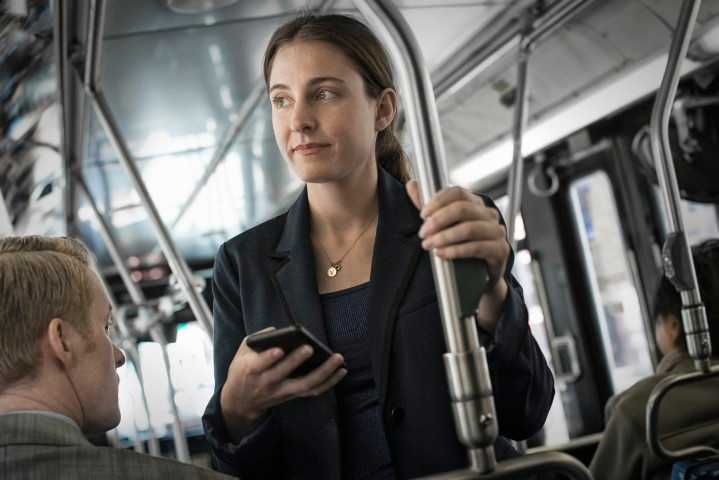 Professional woman using Google on her smartphone