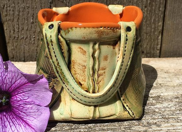 Ceramic planter or purse